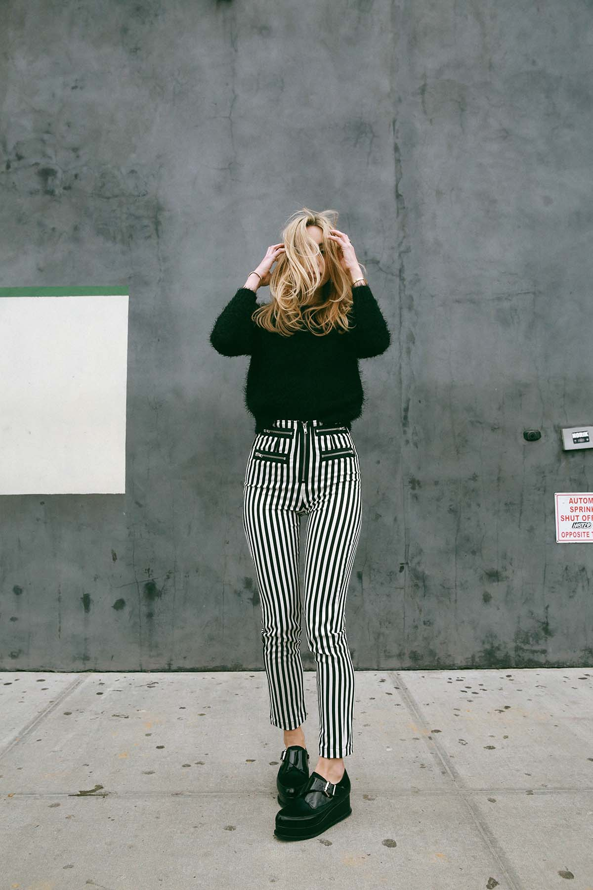 Ana Prodanovich wearing vertical striped pants from Reformation.