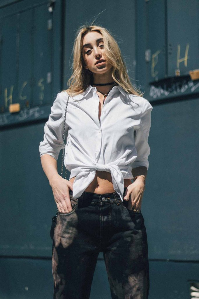 Ana Prodanovich wearing bleach splattered denim from Urban Outfitters.