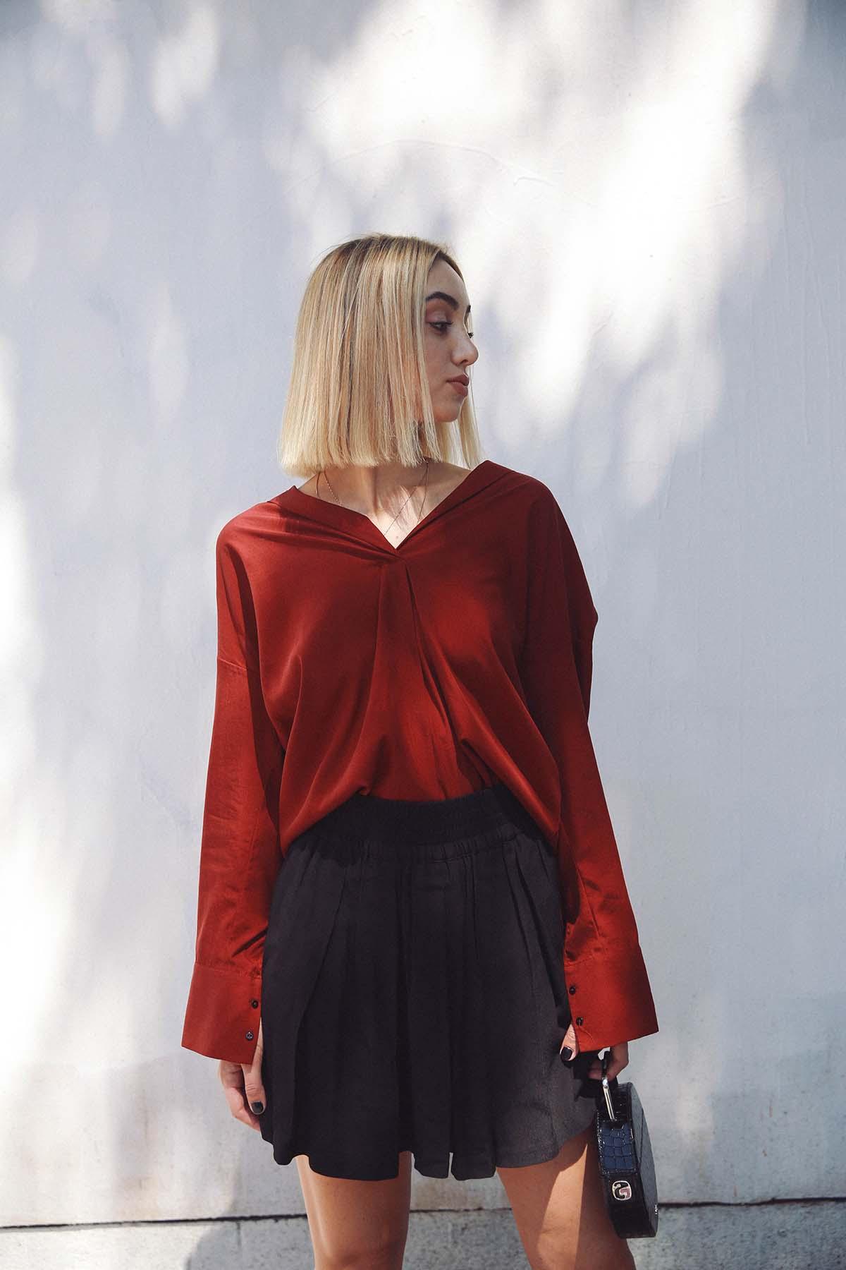 Ana Prodanovich wearing autumnal burgundy.
